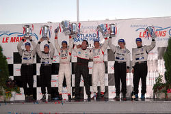 P1 podium: class and overall winners Frank Biela and Emanuele Pirro, with Chris Dyson and Andy Wall