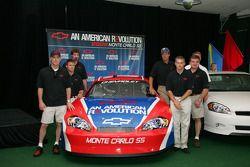Kevin Harvick, Scott Briggs, Boris Said, Michael Waltrip, Bobby Labonte and Joe Nemechek beside the 2006 Monte Carlo SS NASCAR race car