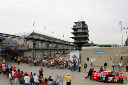 Fans watch Jeremy Mayfield as he is pushed to the garage