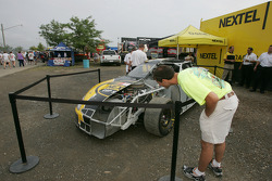 A fan looks at the NASCAR Nextel Cup car on display