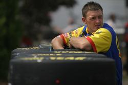 Cheerios Dodge crew member prepares tires