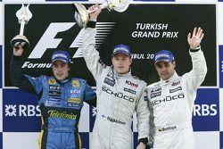Podium: race winner Kimi Raikkonen with Fernando Alonso and Juan Pablo Montoya