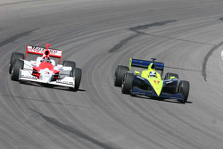 Helio Castroneves and Vitor Meira in corner 4