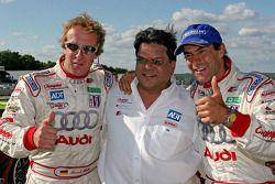 Race winners Frank Biela and Emanuele Pirro celebrate with Dave Maraj