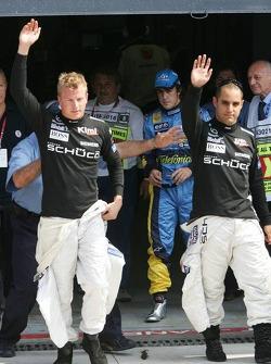 Fastest man Kimi Raikkonen and pole winner Juan Pablo Montoya celebrate