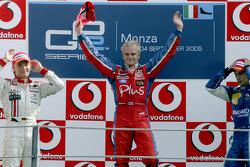 Podium: race winner Heikki Kovalainen with Nico Rosberg and Nelson A. Piquet