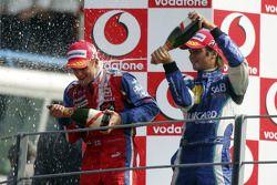 Podium: champagne for Heikki Kovalainen and Nelson A. Piquet