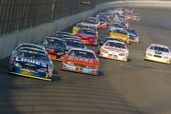 Jimmie Johnson, Justin Labonte, Reed Sorenson and the pack go down the back straight