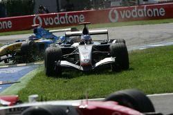 Kimi Raikkonen cuts in the grass