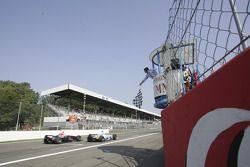 Ferdinando Monfardini and Heikki Kovalainen at finish line