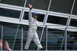 Race winner Juan Pablo Montoya heads to the podium