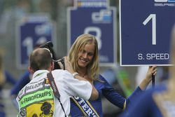 A photographer snaps away at a grid girl
