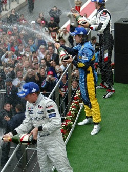 Podium: champagne for Kimi Raikkonen, Fernando Alonso and Jenson Button