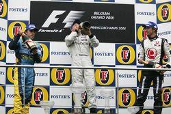 Podium: race winner Kimi Raikkonen with Fernando Alonso and Jenson Button