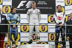Podium: race winner Kimi Raikkonen with Fernando Alonso and Jenson Button