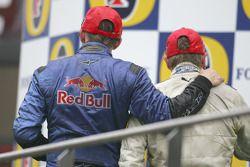 Podium: race winner Adam Carroll with Scott Speed