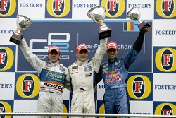 Podium: race winner Adam Carroll with Borja Garcia and Scott Speed