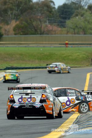 Jason Richards spins in front of team mate Fabian Coulthard