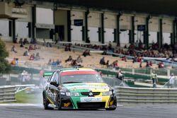 Alex Davison locks a brake at the end of pit straight
