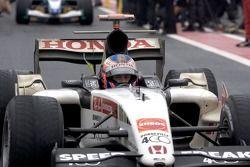 Jenson Button arrives in Parc Fermé