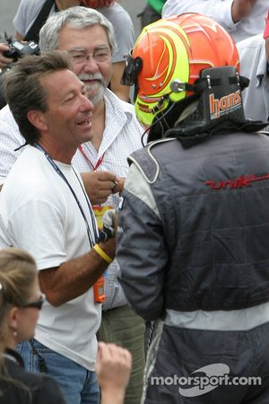 Race winner Antoine Bessette celebrates with Richard Spénard