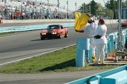 Corner workers showing yellow in turn one