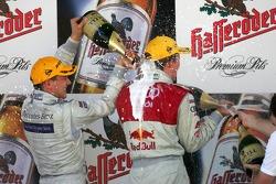 Podium: champagne for Mattias Ekström and Gary Paffett