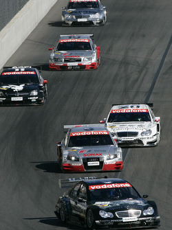 Mika Hakkinen leads a group of cars