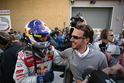 Race winner Mattias Ekström celebrates with Alexander Stehlig
