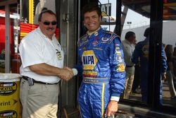 Bill David and Michael Waltrip shake hands during a press conference held to announce their one-year
