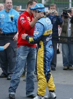 The passing of the crown: Michael Schumacher congratulates 2005 World Champion Fernando Alonso