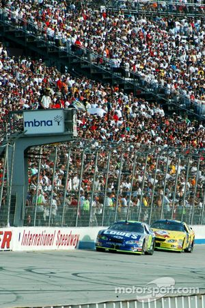 Jimmie Johnson takes the white flag ahead of Kyle Busch