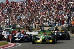Start: Nelson A. Piquet leidt het veld