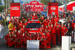 Podium: rally winners Marcus Gronholm and Timo Rautiainen celebrates with their team
