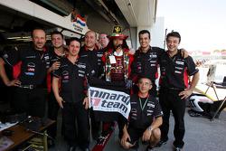 Minardi team members pose with a friend