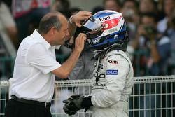 Race winner Kimi Raikkonen celebrates with Ron Dennis