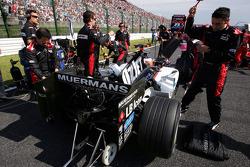 Minardi team members on the starting grid