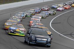 The Ford Fusion pace car leads Matt Kenseth and Elliott Sadler on pace laps