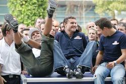 Vitantonio Liuzzi, David Coulthard and Christian Klien pose with Red Bull Racing team members