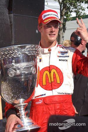Race winner and Champ Car World Series 2005 champion Sébastien Bourdais celebrates poses with the Vanderbilt Cup