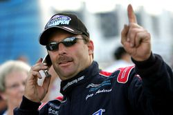 Greg Anderson talks on the phone immediatley following winning the 2005 Pro Stock division at the 5t