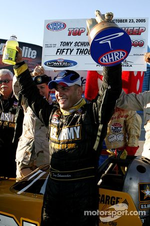 Race winner Tony Schumacher celebrates