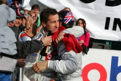 DTM 2005 champion Gary Paffett celebrates with Bernd Schneider