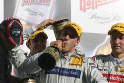 Podium: champagne for Bernd Schneider, Jamie Green and Gary Paffett