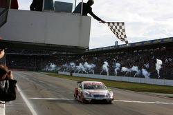 Bernd Schneider takes the checkered flag