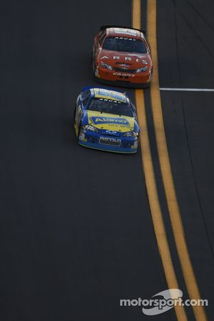 Grant Enfinger leads Daniel Suarez to the finish