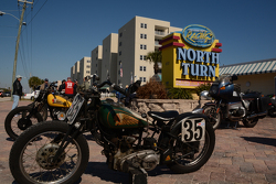 Old-time motorcycles on display in front of