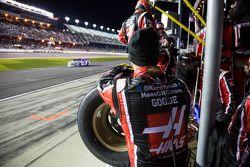 Haas crew members wait on pit road