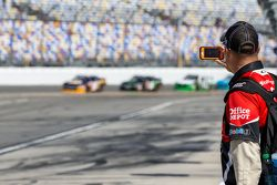 A crew member takes video of practice