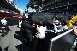 The McLaren MP4-30 of Fernando Alonso, McLaren is recovered back to the pits on the back of a truck
